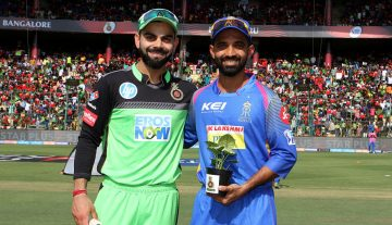 Virat Kohli captain of the Royal Challengers Bangalore and Ajinkya Rahane captain of the Rajasthan Royals during the toss of the match eleven of the Vivo Indian Premier League 2018 (IPL 2018) between the Royal Challengers Bangalore and the Rajasthan Royals held at the M. Chinnaswamy Stadium in Bangalore on the 15th April 2018.